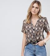 ASOS DESIGN Tall boxy top with contrast buttons in snake animal print-...